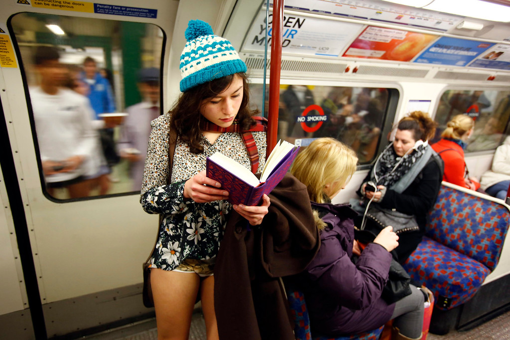 . A woman takes part in a No Pants Day 2014 flash mob on the London Underground, in London, Britain, 12 January 2014. The event is organized by Improv Everywhere and takes place in many cities across the world. The goal for the participants is to get on public transport dressed in normal winter clothes, but without pants while keeping a straight face.  EPA/TAL COHEN