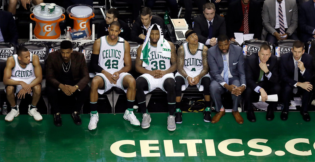 . Boston Celtics players and coaches watch from the bench during the final minutes of Game 1 against the Cleveland Cavaliers during the NBA basketball Eastern Conference finals, Wednesday, May 17, 2017, in Boston. (AP Photo/Charles Krupa)