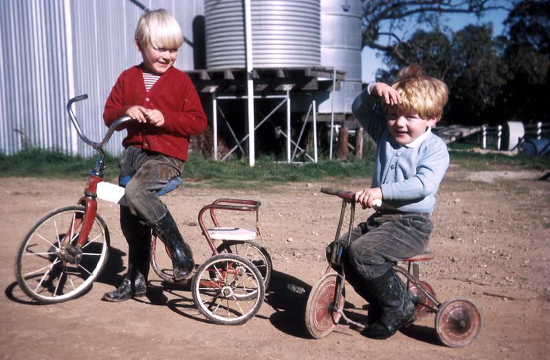1974-5 (34) Andrew 4 yrs 9 mths & Allen 3 yrs riding bikes near shed @ Middlecreek, Flowerdale.jpg