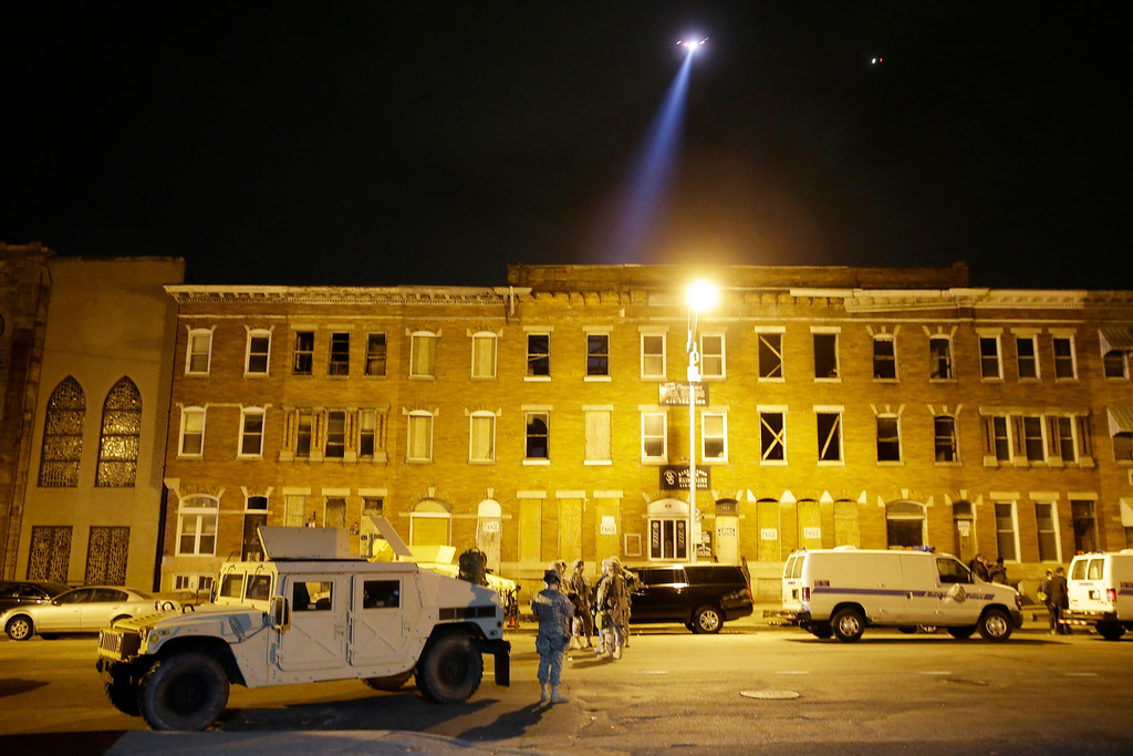 . National Guard stand by during a 10 p.m. curfew Wednesday, April 29, 2015, in Baltimore. The curfew was imposed after unrest in Baltimore over the death of Freddie Gray while in police custody. (AP Photo/Matt Rourke)