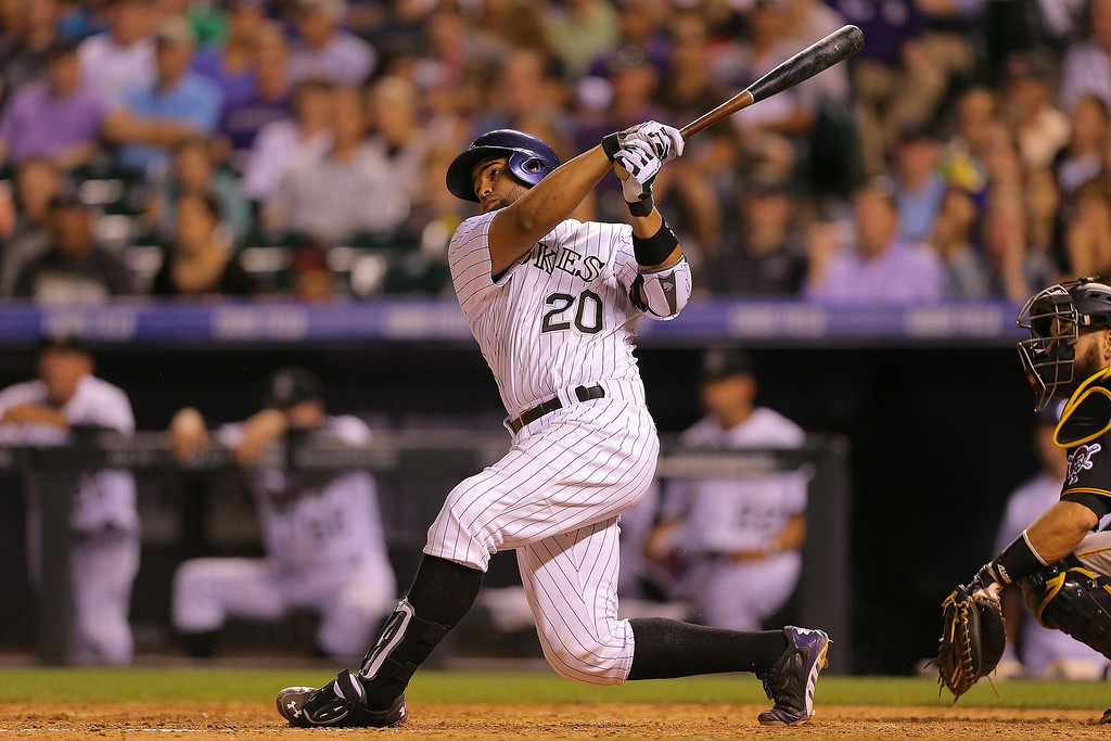 . Wilin Rosario #20 of the Colorado Rockies hits an RBI double during the seventh inning against the Pittsburgh Pirates at Coors Field on July 25, 2014 in Denver, Colorado. (Photo by Justin Edmonds/Getty Images)