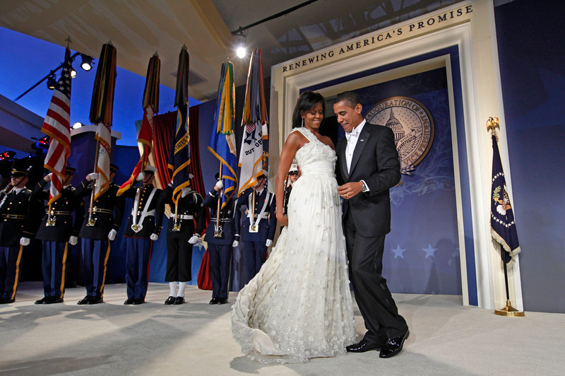 . First lady Michelle Obama moves her dress train as she dances with President Barack Obama at the Youth Inaugural Ball in Washington, Tuesday, Jan. 20, 2009. (AP Photo/Charles Dharapak)