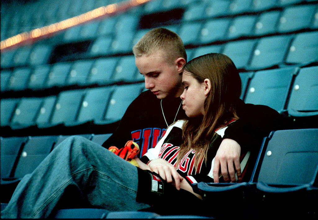 . Taking a break from the hoopla of the Winter Carnival, Ricky Flynn and Crystal McCaulley share a quiet moment in the empty Silverdome seats.