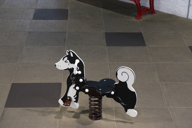 Sled dog toy in the community center