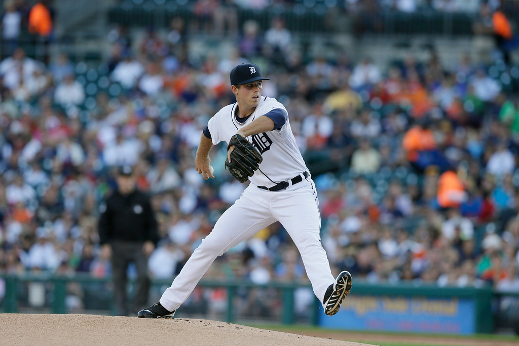 . Detroit Tigers starting pitcher Buck Farmer throws during the first inning of an interleague baseball game against the Pittsburgh Pirates, Wednesday, Aug. 13, 2014 in Detroit. (AP Photo/Carlos Osorio)