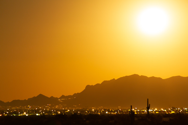 Long exposure of the full moon rising on the desert and city of Phoenix