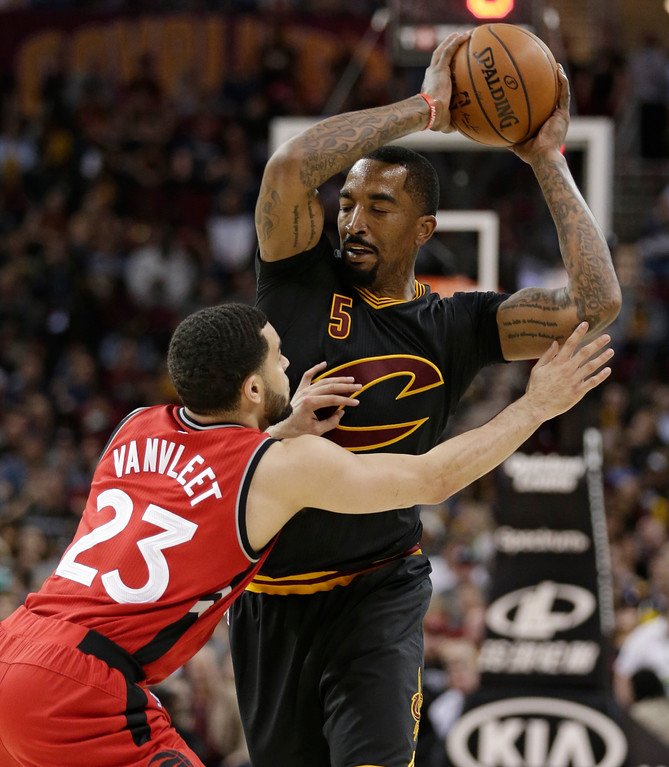 . Cleveland Cavaliers\' J.R. Smith (5) drives past Toronto Raptors\' Fred VanVleet (23) in the first half of an NBA basketball game, Wednesday, April 12, 2017, in Cleveland. The Raptors won 98-83. (AP Photo/Tony Dejak)