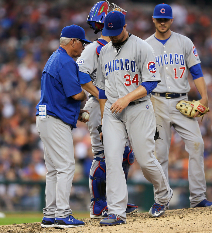 . Chicago Cubs starting pitcher Jon Lester walks off the mound after being removed by manager Joe Maddon during the fifth inning of a baseball game against the Detroit Tigers, Tuesday, June 9, 2015, in Detroit. (AP Photo/Carlos Osorio)