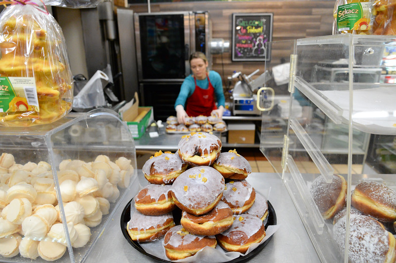 02/28/19  Wesley Bunnell | Staff  Agnes Szpty loads trays and display cases with paczki inside of Polmart at 123 Broad St on Fat Thursday.