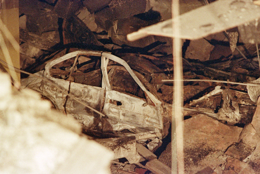 Description of . A destroyed car lies underneath a section of rubble in the sub-basement of New York's World Trade Center, seen Feb. 28, 1993, after an explosion.  Officials continue to investigate the cause and the extent of the damage at the twin towers.  (AP Photo/Ron Frehm)