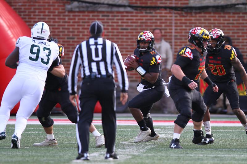 Maryland QB #11 Kasim Hill drops back to pass