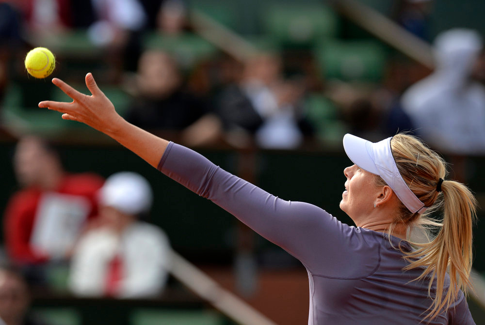 . Russia\'s Maria Sharapova serves to USA\'s Sloane Stephens during their French Tennis Open round of sixteen match at the Roland Garros stadium in Paris, on June 3,  2013. MIGUEL MEDINA/AFP/Getty Images