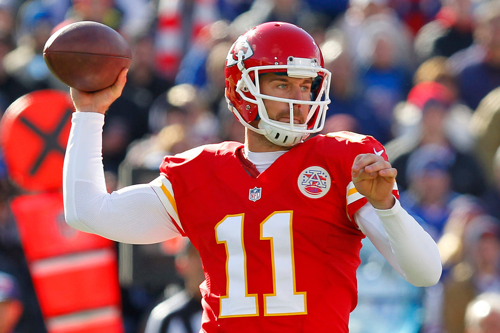 . Kansas City Chiefs quarterback Alex Smith (11) looks to pass during the first quarter of an NFL football game against the Buffalo Bills in Orchard Park, N.Y., Sunday, Nov. 3, 2013. (AP Photo/ Bill Wippert)