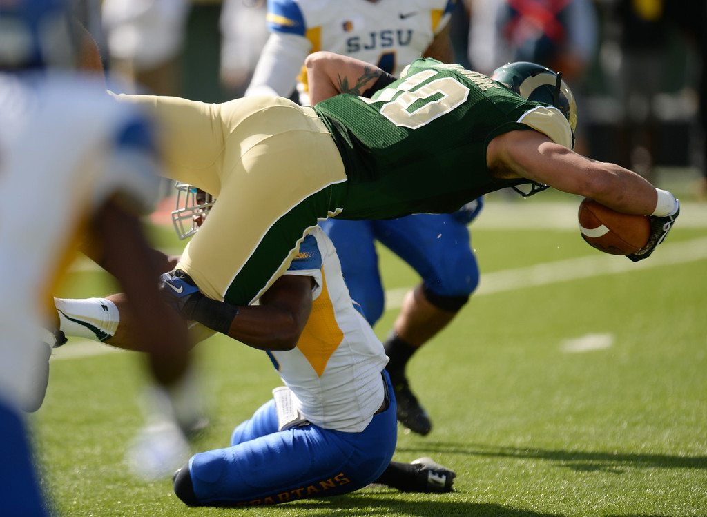 . FORT COLLINS, CO - OCTOBER 12 : Crockett Gillmore of Colorado State (10) dives for a touchdown over Jimmy Pruitt of San Jose State (8) in the 1st quarter of the game at Hughes Stadium. Fort Collins. Colorado. October 12, 2013. San Jose won 34-27. (Photo by Hyoung Chang/The Denver Post)