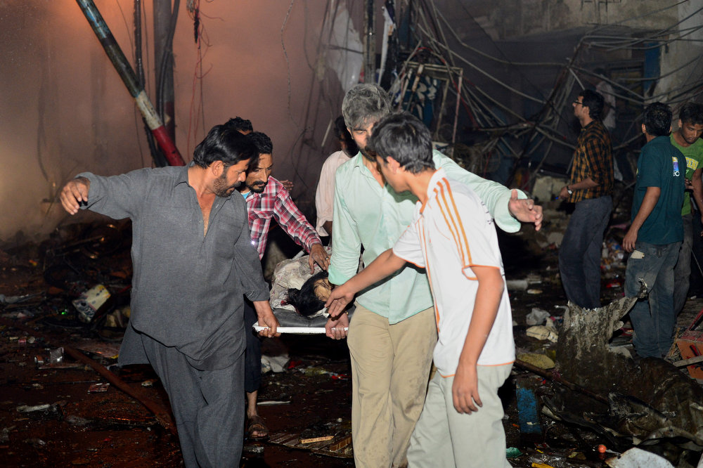 . Pakistani rescuers evacuate a victim from the site of the bomb blast in Karachi on March 3, 2013. A bomb attack in Pakistan\'s largest city Karachi on Sunday killed at least 23 people, including women and children, and wounded 50 others, police said. RIZWAN TABASSUM/AFP/Getty Images