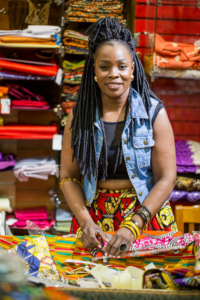 Traditional African fabrics and clothing are available at AfroCentric Network where fabrics from Ghana and Kenya are in great supply.  Agie Ngira is the store manager and she is adding invatory to the large collection of African items.  (Jenni Girtman / Atlanta Event Photography)