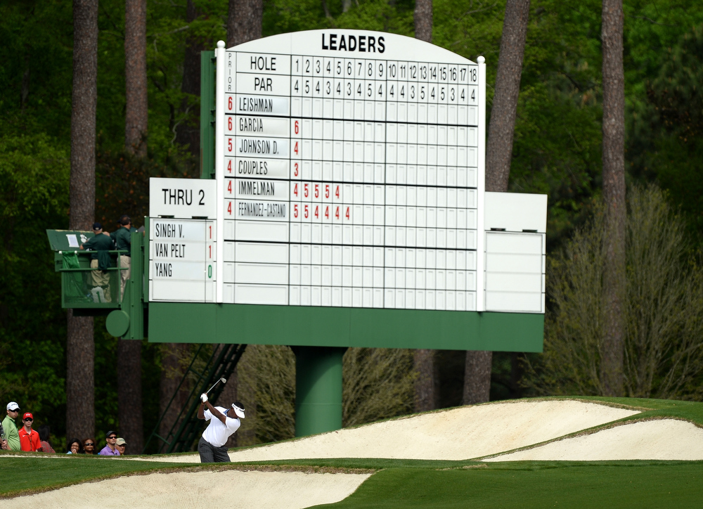 Description of . Vijay Singh of Fiji plays from a bunker on the third hole during the second round of the 2013 Masters Tournament at Augusta National Golf Club on April 12, 2013 in Augusta, Georgia.  (Photo by Harry How/Getty Images)