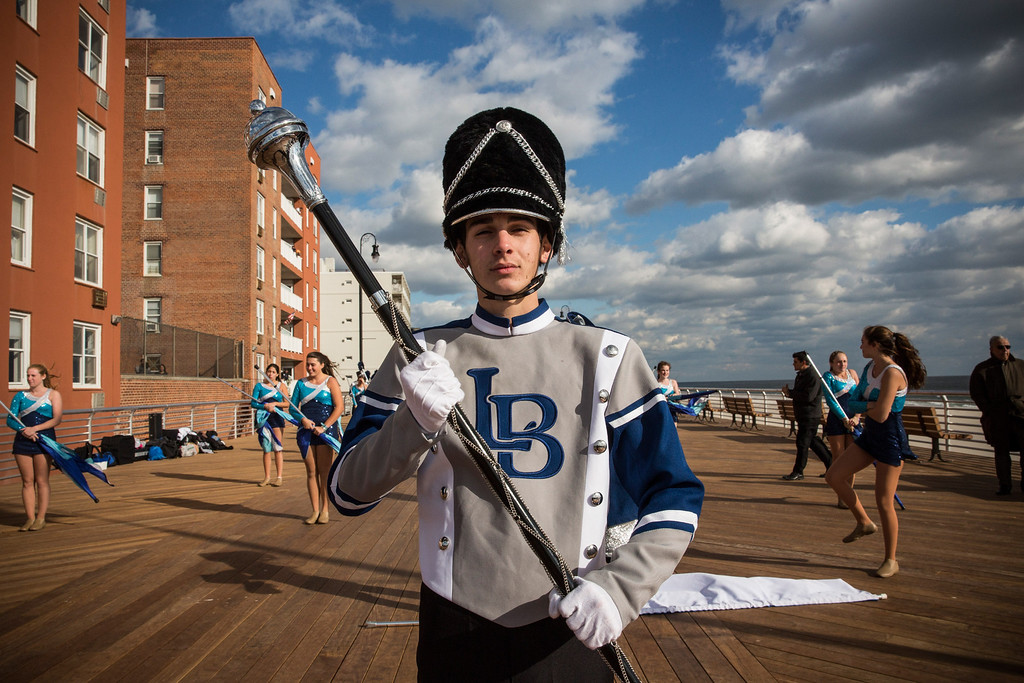 . LONG BEACH, NY - OCTOBER 25:  Alex Schneider, of the Long Beach High School marching band, prepares to march down the Long Beach boardwalk during a ceremony to officially reopen the boardwalk on October 25, 2013 in Long Beach, New York. The boardwalk was severely damaged by Superstorm Sandy last year, which killed 285 people and caused billions of dollars in damage. Long Beach\'s new boardwalk is made of Brazilian hardwood and is estimated to have a lifespan of 30-40 year; the previous boardwalk was only scheduled to last  three to seven years.  (Photo by Andrew Burton/Getty Images)