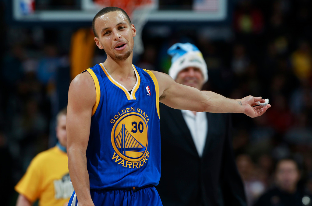 . Golden State Warriors guard Stephen Curry argues for a call against the Denver Nuggets in the fourth quarter of the Warriors\' 89-81 victory in an NBA basketball game in Denver, Monday, Dec. 23, 2013. (AP Photo/David Zalubowski)