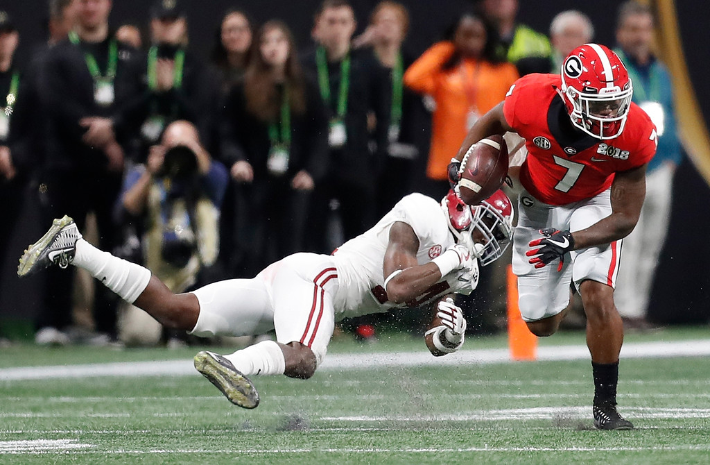 . Georgia running back D\'Andre Swift gets past Alabama\'s Deionte Thompson during the first half of the NCAA college football playoff championship game Monday, Jan. 8, 2018, in Atlanta. (AP Photo/David Goldman)
