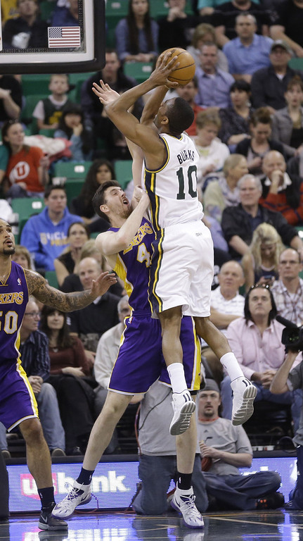 . Los Angeles Lakers\' Ryan Kelly (4) defends against Utah Jazz\'s Alec Burks (10) in the second half during an NBA basketball game Monday, April 14, 2014, in Salt Lake City, Utah. (AP Photo/Rick Bowmer)