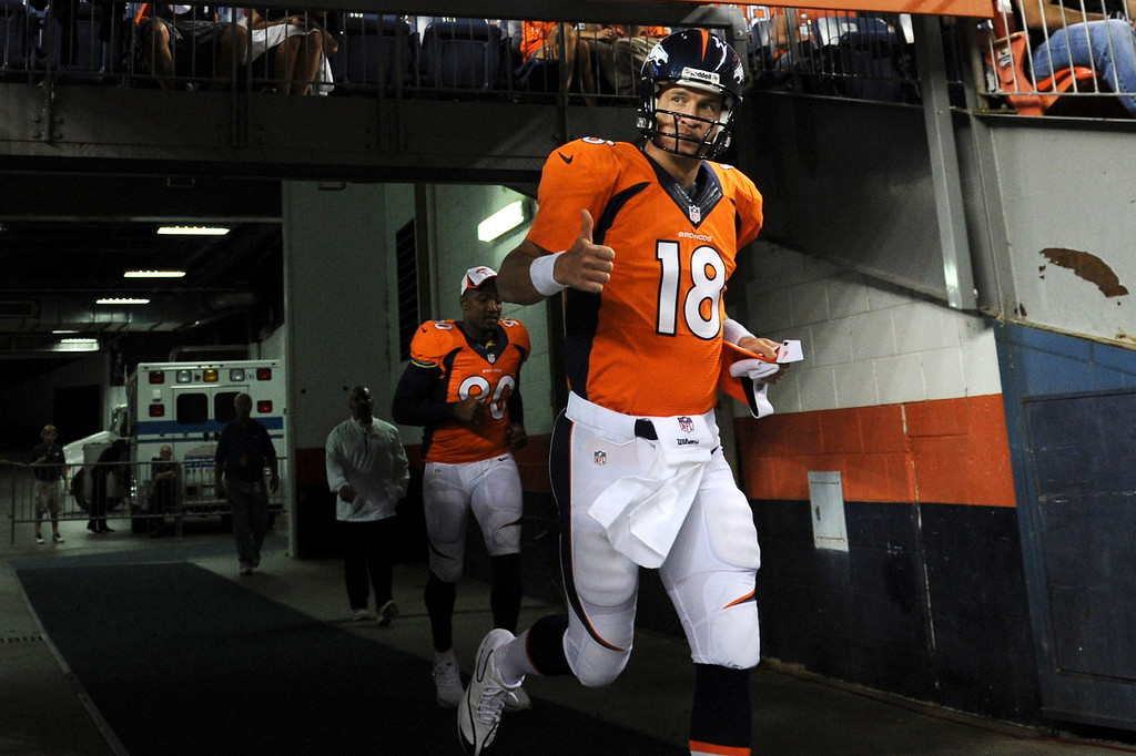 . Peyton Manning (18) of the Denver Broncos runs on to the field for the second half of the last pre-season game of the season at Sports Authority Field at Mile High. August 29, 2013 Denver, Colorado. (Photo By Joe Amon/The Denver Post)