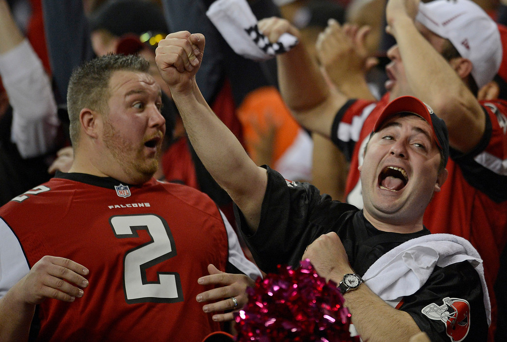 . Falcons fans react after a catch by Atlanta Falcons\' Harry Douglas is ruled in the home team\'s favor after being challenged in the fourth quarter of their NFC Championship game on Sunday, Jan. 20, 2013, at the Georgia Dome in Atlanta. San Francisco defeated Atlanta 28-24. (Jose Carlos Fajardo/Bay Area News Group)