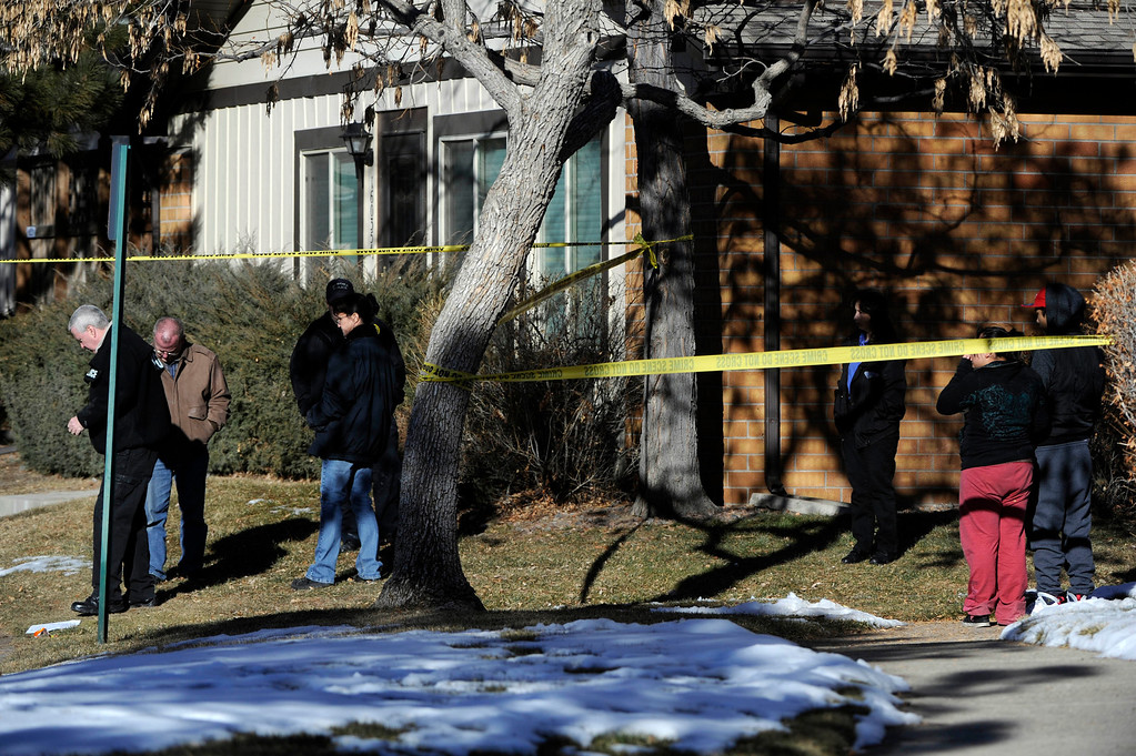 . Aurora Police investigators, left, start their work at a crime scene at 16005 Ithaca Place in Aurora Saturday afternoon. The bodies of four people, including a gunman are dead at the scene following a standoff situation early Saturday morning. The Denver Post/ Andy Cross