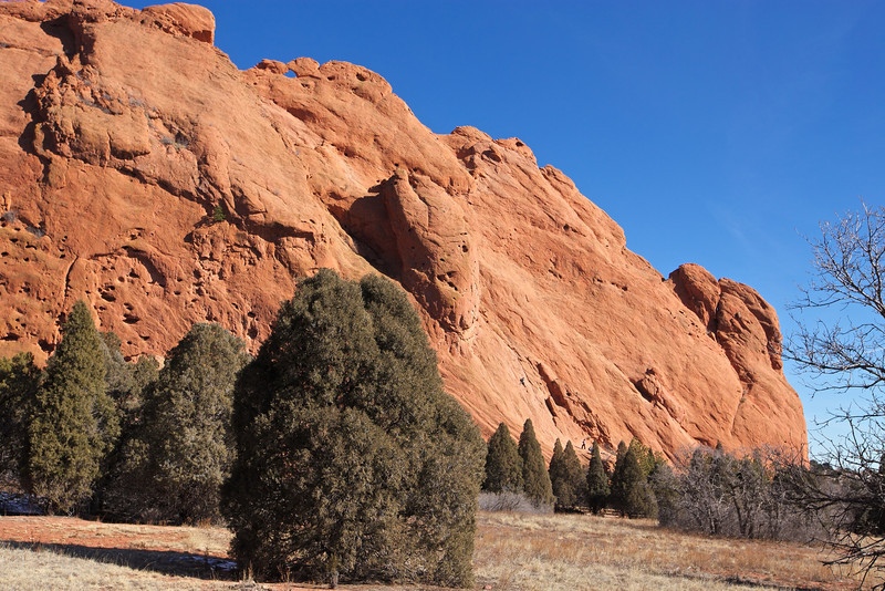 At the Garden of the Gods park. There is a rock climber on the lower right face.