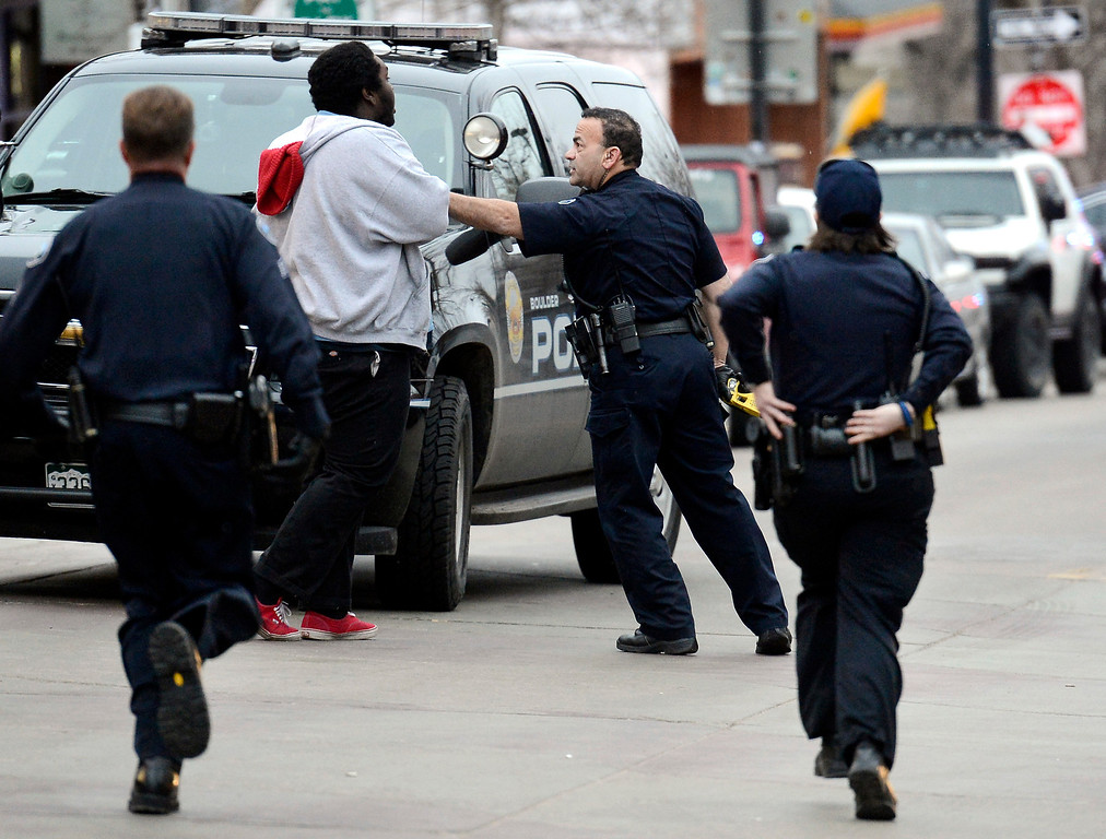 . Boulder Police officers work to keep an unidentified man under control during a disturbance at the The Fox Theater on Monday, March 11, in Boulder. Boulder Police responded with riot gear to keep the fans of the band Tyler the Creator under control.  Jeremy Papasso/Boulder Daily Camera