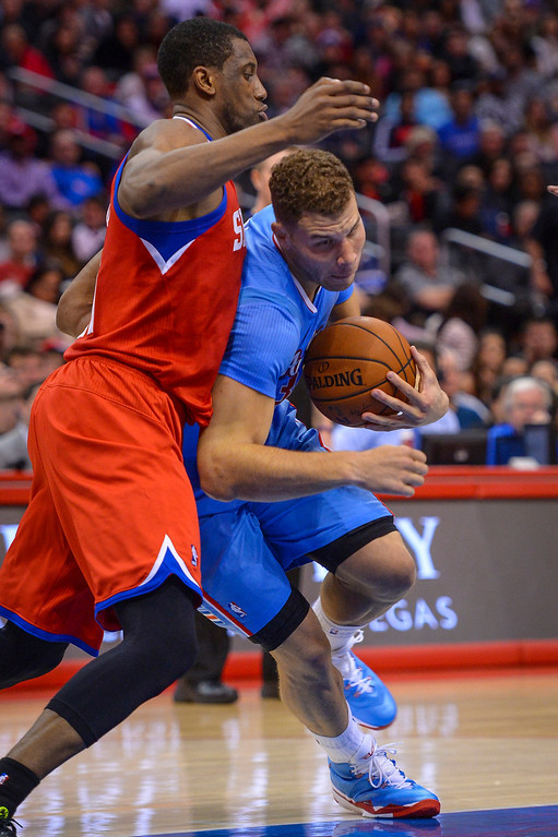 . Clippers� Blake Griffin gets past 76ers�  Thaddeus Young during first half action at Staples Center Sunday.  ( Photo by David Crane/Los Angeles Daily News )