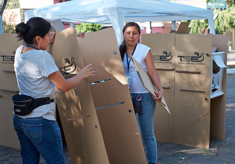 Election officials in Santa Ana  assemble the voting booths.