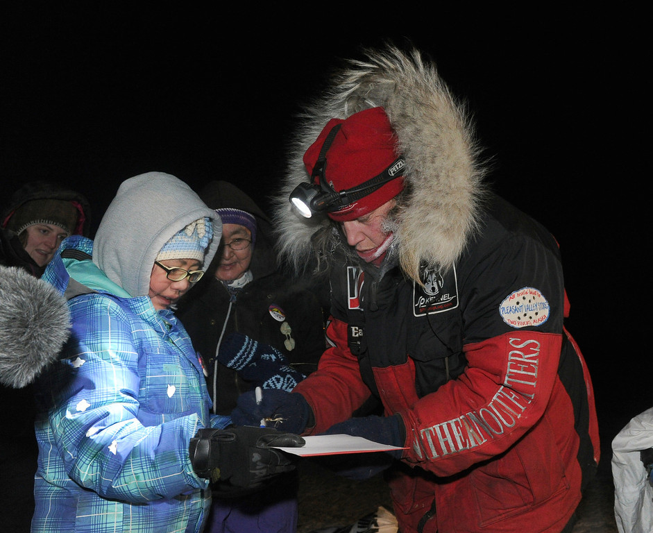 . Melody Bergamaschi has her Aliy Iditarod book signed by Iditarod musher Aliy Zirkle, from Two Rivers, Alaska, at the White Mountain checkpoint during the Iditarod Trail Sled Dog Race on Monday, March 10, 2014. (AP Photo/The Anchorage Daily News, Bob Hallinen)
