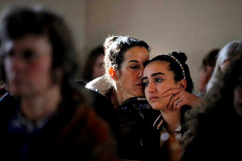 Description of . Elizabeth Bogdanoff, left, kisses her daughter Julia, 13, both of Newtown, Conn., during a prayer service at St John's Episcopal Church in Newtown, Saturday, Dec. 15, 2012. The massacre of 26 children and adults at Sandy Hook Elementary school elicited horror and soul-searching around the world even as it raised more basic questions about why the gunman, 20-year-old Adam Lanza, would have been driven to such a crime and how he chose his victims. (AP Photo/David Goldman)