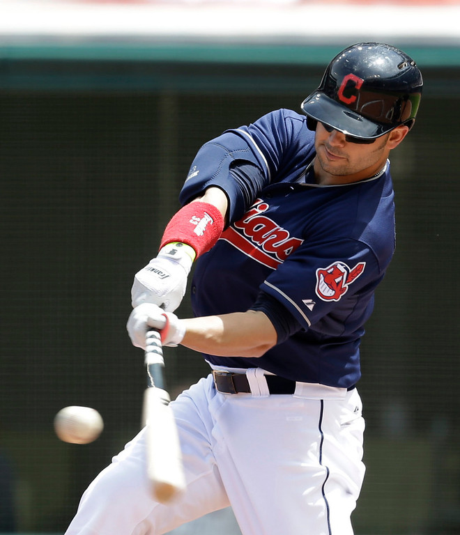 . Cleveland Indians\' Nick Swisher hits a solo home run off Minnesota Twins starting pitcher Kevin Correia in the first inning. (AP Photo/Tony Dejak)