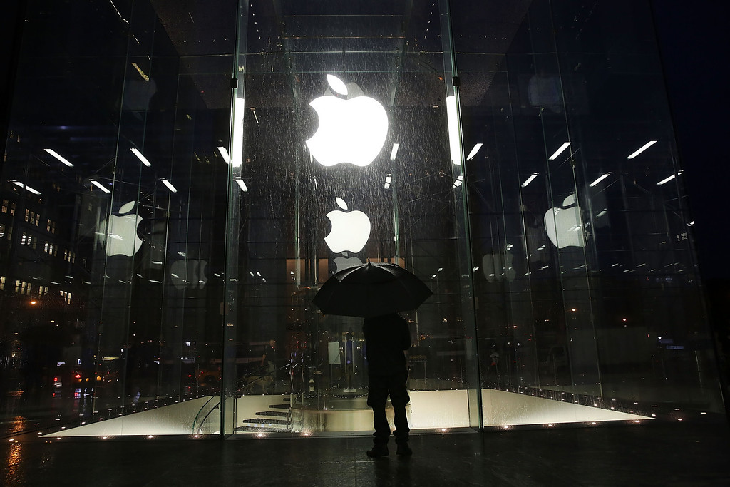 . A man stands in front of the Apple Store before it opened on the day the company will sell their new iPad Air, the fifth generation of its tablet on November 1, 2013 in New York City. (Photo by Spencer Platt/Getty Images)