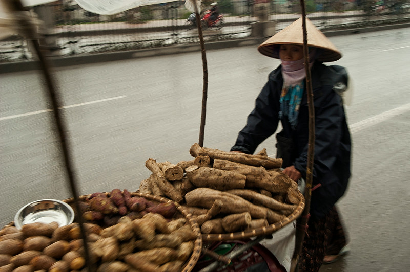 selling potatoes.  Vietnam, 2008.