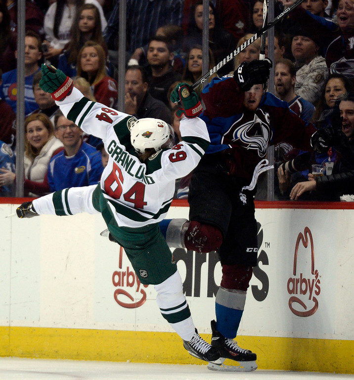 . Mikael Granlund (64) of the Minnesota Wild collides with Gabriel Landeskog (92) of the Colorado Avalanche during the first period of action. The Colorado Avalanche hosted the Minnesota Wild in the first round of the Stanley Cup Playoffs at the Pepsi Center in Denver, Colorado on Saturday, April 19, 2014. (Photo by John Leyba/The Denver Post)