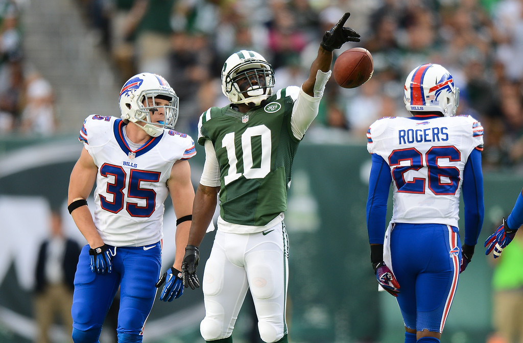 . Wide receiver Santonio Holmes #10 of the New York Jets celebrates after a 1st down in the 1st half of the Jets game against the Buffalo Bills at MetLife Stadium on September 22, 2013 in East Rutherford, New Jersey. (Photo by Ron Antonelli/Getty Images)