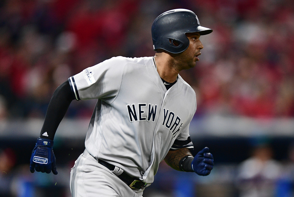 . New York Yankees\' Aaron Hicks watches his double off Cleveland Indians starting pitcher Trevor Bauer during the sixth inning of Game 1 of a baseball American League Division Series, Thursday, Oct. 5, 2017, in Cleveland. (AP Photo/David Dermer)