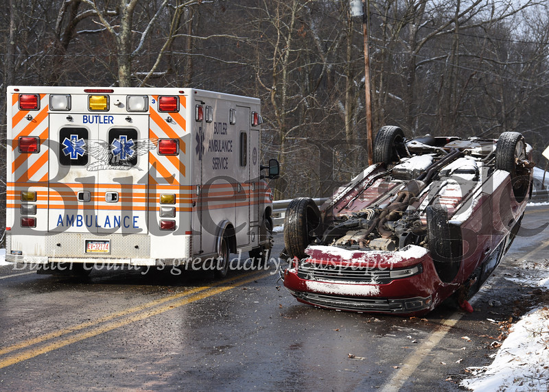Harold Aughton/Butler Eagle: An ambulance transports a woman from the scene of an accident after her Ford Flex flipped over on its roof during a snow sqaw on Bruin road Wednesday, January 8, 2020.