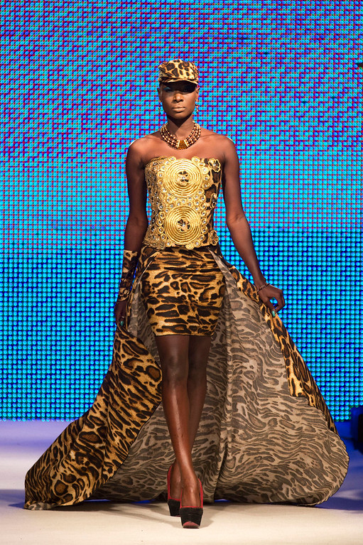 . A model wears a creation by designer Habib Sangare of Ivory Coast, at Hotel des Almadies, in Dakar, Senegal, Saturday, June 22, 2013. After a Friday show held in a dusty marketplace in the working class suburb of Guediawaye, the runway finale of Dakar Fashion Week was held at a luxury hotel and showcased the work of 14 designers from West Africa, Europe, South America, and the Caribbean. (AP Photo/Rebecca Blackwell)