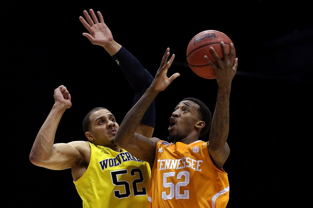 . Jordan McRae #52 of the Tennessee Volunteers shoots the ball against Jordan Morgan #52 of the Michigan Wolverines during the regional semifinal of the 2014 NCAA Men\'s Basketball Tournament at Lucas Oil Stadium on March 28, 2014 in Indianapolis, Indiana.  (Photo by Jonathan Daniel/Getty Images)