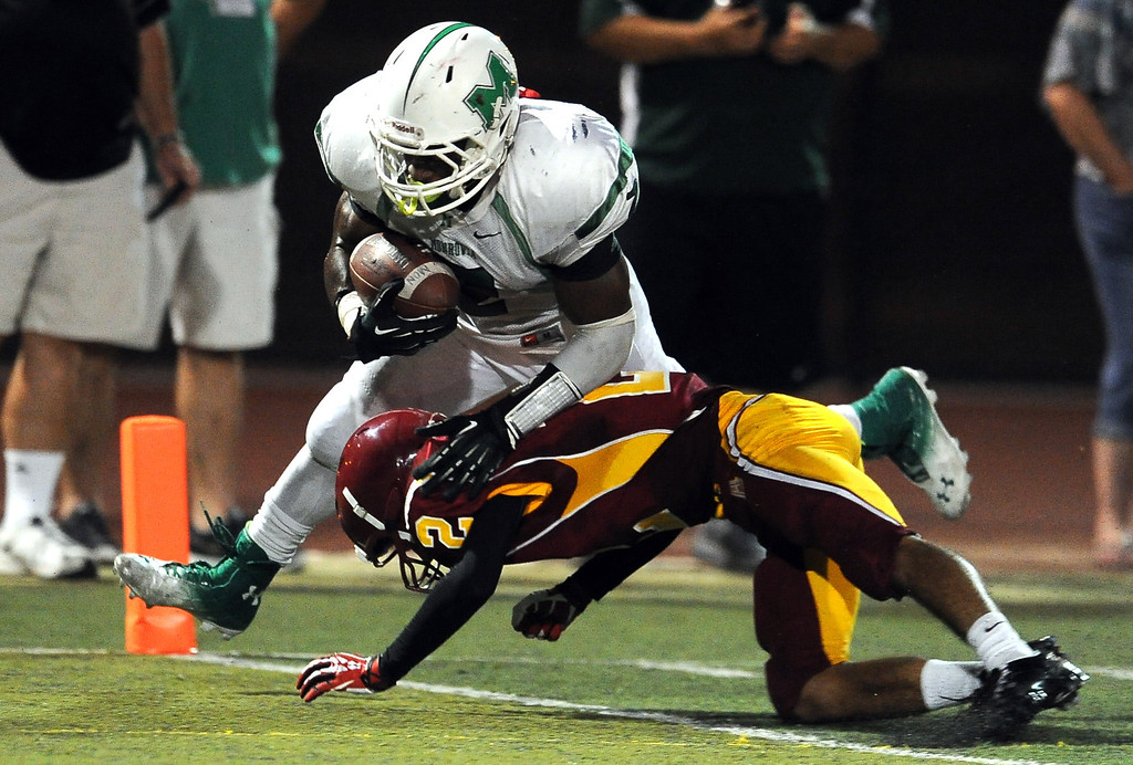 . Monrovia\'s Kurt Scoby (2) runs for a touchdown over Arcadia\'s Robbie Hiller (2) in the first half of a prep football game at Arcadia High School in Arcadia, Calif. on Friday, Sept. 13, 2013.   (Photo by Keith Birmingham/Pasadena Star-News)