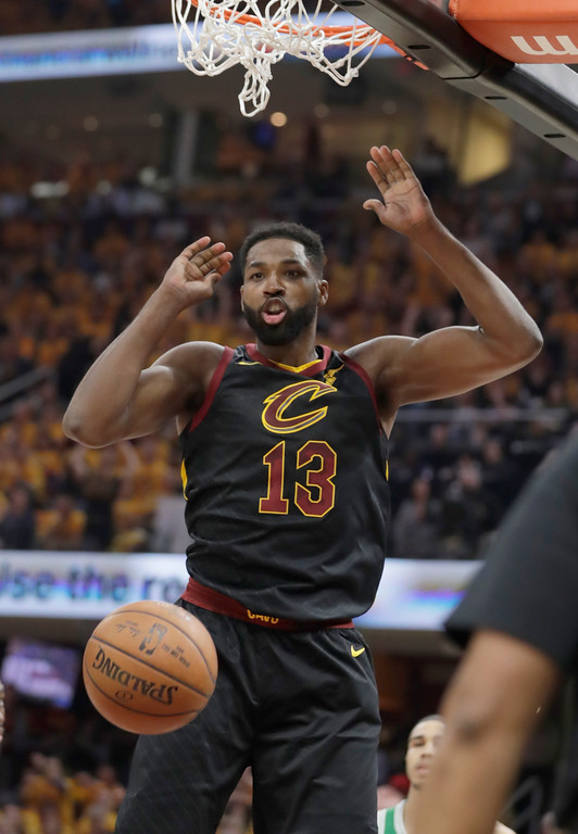 . Cleveland Cavaliers\' Tristan Thompson (13) reacts after dunking against the Boston Celtics in the first half of Game 3 of the NBA basketball Eastern Conference finals, Saturday, May 19, 2018, in Cleveland. (AP Photo/Tony Dejak)