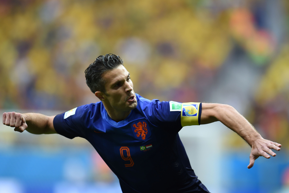 . Netherlands\' forward and captain Robin van Persie celebrates after scoring a goal during the third place play-off football match between Brazil and Netherlands during the 2014 FIFA World Cup at the National Stadium in Brasilia on July 12, 2014. (VANDERLEI ALMEIDA/AFP/Getty Images)