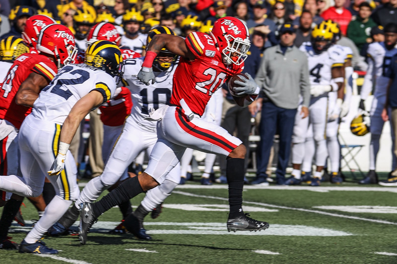 Maryland RB Javon Leake escapes through a cap in the line.