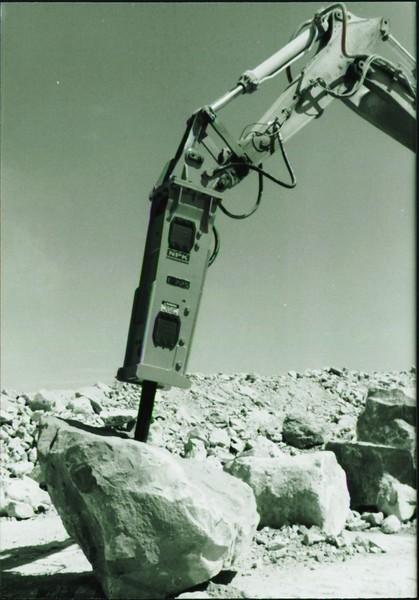 NPK E225 hydraulic hammer on Cat excavator at Marblehead quarry (11).JPG