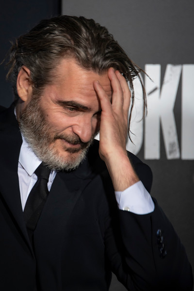 """HOLLYWOOD, CALIFORNIA - SEPTEMBER 28: Lawrence Sher and Joaquin Phoenix attend the premiere of Warner Bros Pictures """"Joker"""" on Saturday, September 28, 2019 in Hollywood, California. (Photo by Tom Sorensen/Moovieboy Pictures)"""