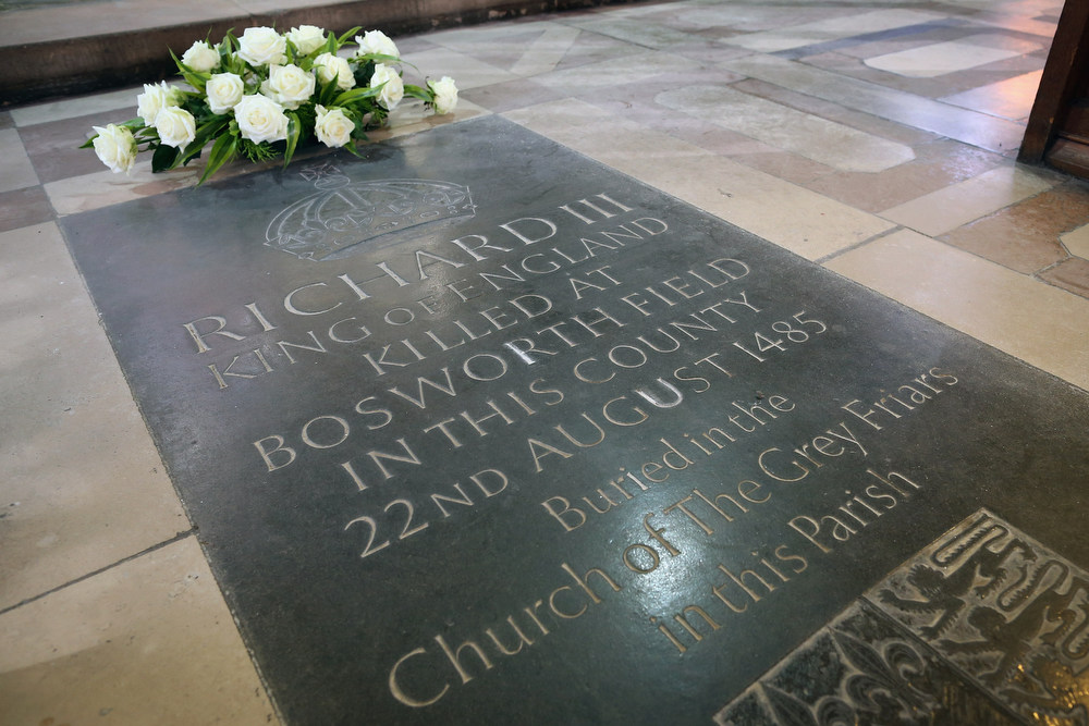 Description of . Flowers sit on a memorial stone marking the death of King Richard III inside Leicester Cathedral, close to where the body of Richard III was discovered, on February 4, 2013 in Leicester, England. The University of Leicester has been carrying out scientific investigations on remains found in a car park to find out whether they are those of King Richard III since last September, when the skeleton was discovered in the foundations of Grey friars Church, Leicester. King\'s Richard III\'s remains are to be re-interred at Leicester Catherdral.  (Photo by Dan Kitwood/Getty Images)